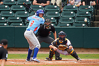 Tennessee Smokies third baseman Wes Darvill (8) at bat in front of catcher Justin O'Conner and umpire Alex Ransom during a game against the Montgomery Biscuits on May 25, 2015 at Riverwalk Stadium in Montgomery, Alabama.  Tennessee defeated Montgomery 6-3 as the game was called after eight innings due to rain.  (Mike Janes/Four Seam Images)