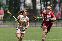 NEWTON, MA - MAY 16: Annie Walsh #3 of Boston College brings the ball forward as Belle Mastropietro #12 of Temple University closes during NCAA Division I Women's Lacrosse Tournament second round game between Temple University and Boston College at Newton Campus Lacrosse Field on May 16, 2021 in Newton, Massachusetts.