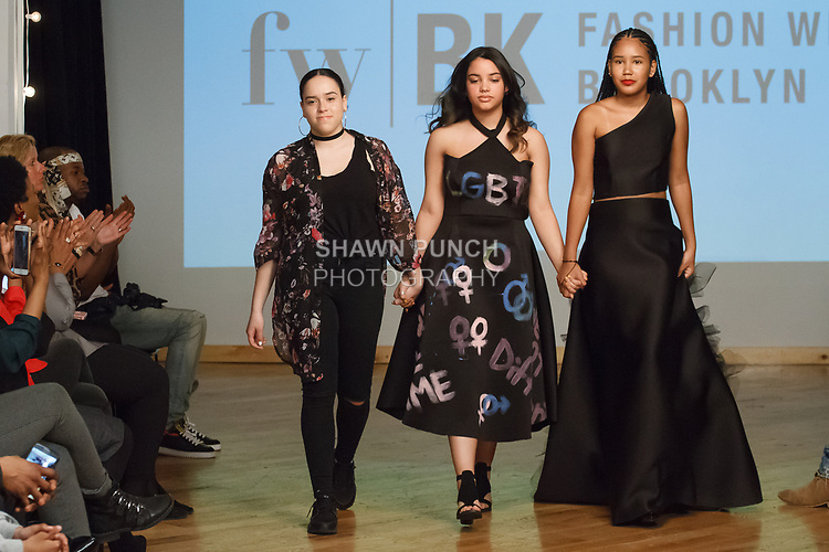 Model walks runway with student designer for the close of the William H. Maxwell CTE High School Fall Winter 2018 collection, at the Young Designers Showcase for Fashion Week Brooklyn Fall Winter 2018 at The Automatic Studios, on April 10, 2018.