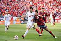 Eric Lichaj (14) of the United States challenges Alvaro Negredo (22) of Spain for the ball. The men's national team of Spain (ESP) defeated the United States (USA) 4-0 during a International friendly at Gillette Stadium in Foxborough, MA, on June 04, 2011.