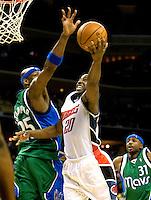 Charlotte Bobcats Raymond Felton shoots around the Dallas Mavericks during an NBA basketball game Time Warner Cable Arena in Charlotte, NC.