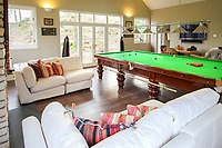 BNPS.co.uk (01202) 558833. <br /> Pic: Bidwells/BNPS<br /> <br /> Pictured: A snooker table and lounge space.<br /> <br /> Better than a gravy boat...<br /> <br /> A striking country house built by a bishop as a wedding gift for his son is on the market for offers over £2m.<br /> <br /> Dunbeg House sits in an incredible position on the bank of a loch with stunning panoramic water and mountain views.<br /> <br /> The impressive property not only includes the five-bedroom main house, but also a two-bedroom cottage that has been run as a successful holiday let and over four acres of woodland garden.