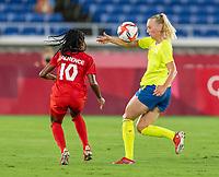YOKOHAMA, JAPAN - AUGUST 6: Sofia Jakobsson #10 of Sweden controls the ball during a game between Canada and Sweden at International Stadium Yokohama on August 6, 2021 in Yokohama, Japan.