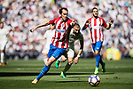 Diego Roberto Godin Leal of Atletico de Madrid in action during their La Liga match between Real Madrid and Atletico de Madrid at the Santiago Bernabeu Stadium on 08 April 2017 in Madrid, Spain. Photo by Diego Gonzalez Souto / Power Sport Images