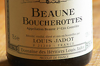 Closeup close-up of a wine bottle label Maison Domaine des Heritiers Louis Jadot Bourgogne Beaune Boucherottes Premier 1er Cru Appellation Controlee, Maison Louis Jadot, Beaune Côte Cote d Or Bourgogne Burgundy Burgundian France French Europe European