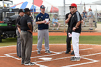 Illinois State Redbirds Bo Durkac (right) during the lineup exchange with Scott Heather and umpires Lou Kammermeier (behind Durkac), Ron Brown and Edward Hudson (glasses on back of hat) before a game against the Bucknell Bison on March 8, 2015 at North Charlotte Regional Park in Port Charlotte, Florida.  Bucknell defeated Illinois State 13-8.  (Mike Janes Photography)
