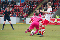 Referee Brian Colvin gives Airdrie a second penalty after Airdrie's Scott Fraser is brought down by Stirling's Ross Forsyth.