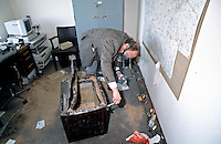 Scenes of crime officer dusting for fingerprints after burglars broke in and attacked a safe with an angle grinder. He is using a brush with magnesium powder to highlight the prints. This image may only be used to portray the subject in a positive manner..©shoutpictures.com..john@shoutpictures.com