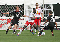 Adam Cristman #7 and Stephen King #20 of D.C. United close in on Tony Tchani #23 of the New York Red Bulls during an MLS match on May 1 2010, at RFK Stadium in Washington D.C.