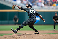 Vanderbilt Commodores pitcher Kumar Rocker (80) delivers a pitch to the plate against the Mississippi State Bulldogs in the NCAA College World Series on June 19, 2019 at TD Ameritrade Park in Omaha, Nebraska. Vanderbilt defeated Mississippi State 6-3. (Andrew Woolley/Four Seam Images)