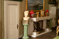 BNPS.co.uk (01202) 558833<br /> Pic: ZacharyCulpin/BNPS<br /> <br /> There's classical sculptures on show at the house<br /> <br /> A model maker who spent 25 years building a stunning miniature Georgian mansion has put it up for sale for £8,750.<br /> <br /> Len Martin spared no expense or time in creating the incredibly ornate model home that includes Swarovski chandeliers, gold furniture and artwork from Egyptian King Farouk's artist.<br /> <br /> The 42ins tall property also boasts a sweeping driveway, 16 statues, 138 balustrades, marble floors, stone cherubs on the ceilings and more tiny oil paintings crafted by real artists.