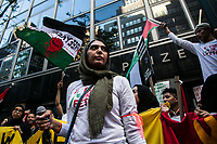 NEW YORK, NY - JUNE 15: View of a woman with a large group of pro-Palestinian protesters wave flags during a large protest alongside the Consulate General of Israel in New York on June 15, 2021. The solidarity action of hundreds pro-Palestinian is a form of support against the attacks carried out by the Israeli government. At the same time, Palestinian Prime Minister Mohammad Shtayyeh says the new Israeli government is just as bad as the old one and condemns Naftali Bennett's announcements in support of Israeli settlements. That is why the demonstrations continue in different parts of the world. (Photo by Pablo Monsalve / VIEWpress via Getty Images