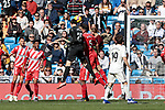 Real Madrid's Thibaut Courtois and Girona FC's Pedro Alcala fight for the ball during La Liga match between Real Madrid and Girona FC at Santiago Bernabeu Stadium in Madrid, Spain. February 17, 2019. (ALTERPHOTOS/A. Perez Meca)
