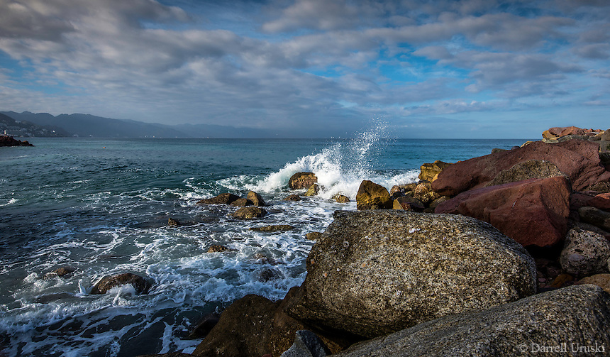 Fine Art Landscape, Photograph of a seascape scene in Puerto Vallarta Mexico. The morning lighting was perfect as the long rays of the morning sun brought out the textures and details of clouds, the ocean waves crashing down onto the rocky shoreline.