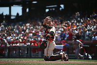 SAN FRANCISCO, CA - JUNE 19:  Buster Posey #28 of the San Francisco Giants works behind the plate against the Philadelphia Phillies during the game at Oracle Park on Saturday, June 19, 2021 in San Francisco, California. To honor Juneteenth the Giants wore 1946 San Francisco Sea Lions uniforms to celebrate to the West Coast Negro Baseball Association club's 75th anniversary. (Photo by Brad Mangin)
