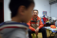 CHINA. Beijing. Li Rui'an (3) at home with his father, Li Yong'an. Li Rui'an is the second child in the family. In wake of the approaching census, family's are having trouble registering their second child in the one-child state. 2010