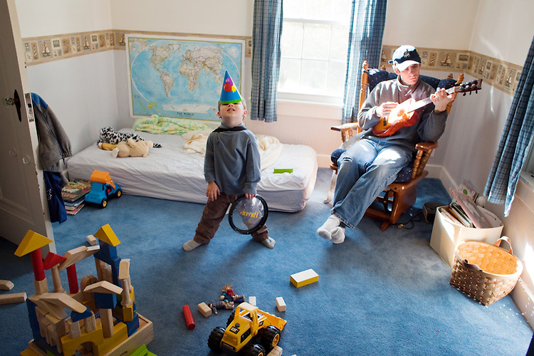 My older son, age three, and my husband  relax in the boy's bedroom.