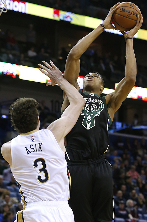 Milwaukee Bucks forward Giannis Antetokounmpo (34) shoots over New Orleans Pelicans center Omer Asik (3) during the first half of an NBA basketball game Saturday, Jan. 23, 2016, in New Orleans. (AP Photo/Jonathan Bachman)