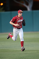 Cameron Frost (35) of the Washington State Cougars returns to the dugout between innings of a game against the Southern California Trojans at Dedeaux Field on March 13, 2015 in Los Angeles, California. Southern California defeated Washington State, 10-3. (Larry Goren/Four Seam Images)