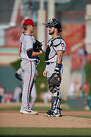 Richmond Flying Squirrels pitcher Caleb Baragar (38) talks with catcher Joey Bart (33) during an Eastern League game against the Erie SeaWolves on August 28, 2019 at UPMC Park in Erie, Pennsylvania.  Richmond defeated Erie 6-4 in the first game of a doubleheader.  (Mike Janes/Four Seam Images)