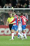 Referee Pizarro Gomez shows yellow card to Granada CF's Adrian Ramos  during La Liga 2 match. February 10,2019. (ALTERPHOTOS/Alconada)