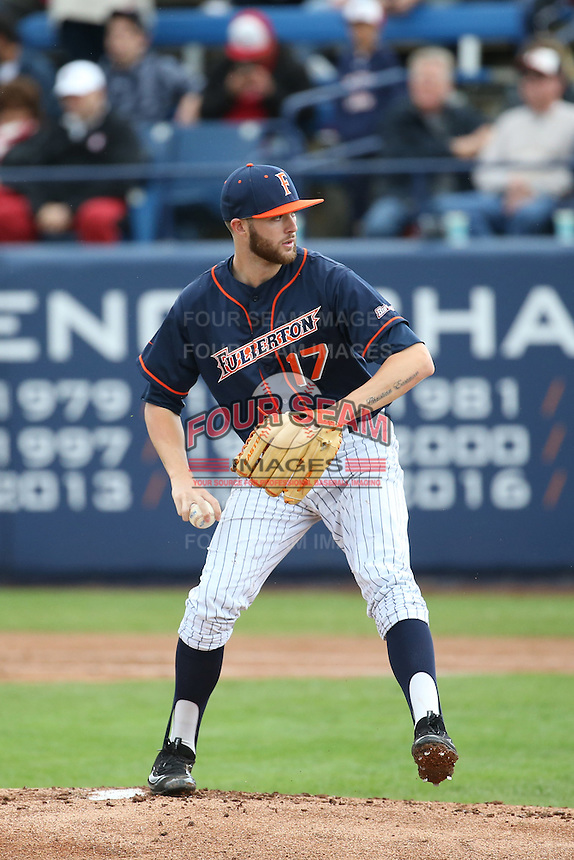 Colton Eastman #17 of the Cal State Fullerton Titans pitches against the Stanford Cardinal at Goodwin Field on February 19, 2017 in Fullerton, California. Stanford defeated Cal State Fullerton, 8-7. (Larry Goren/Four Seam Images)