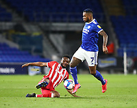 16th March 2021; Cardiff City Stadium, Cardiff, Glamorgan, Wales; English Football League Championship Football, Cardiff City versus Stoke City; Mikel John Obi of Stoke City slide tackles Leandro Bacuna of Cardiff City
