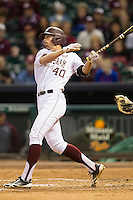 Texas A&M Aggie outfielder Jonathan Moroney #40 follows through on his swing against the Houston Cougars in the NCAA baseball game on March 1st, 2013 at Minute Maid Park in Houston, Texas. Houston defeated Texas A&M 7-6. (Andrew Woolley/Four Seam Images).
