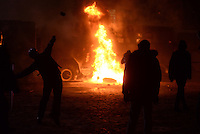 Rioters throw stones and molotov cocktails against police trucks during the   protest against new draconian law to ban the right to  protest across the country.  Kiev. Ukraine