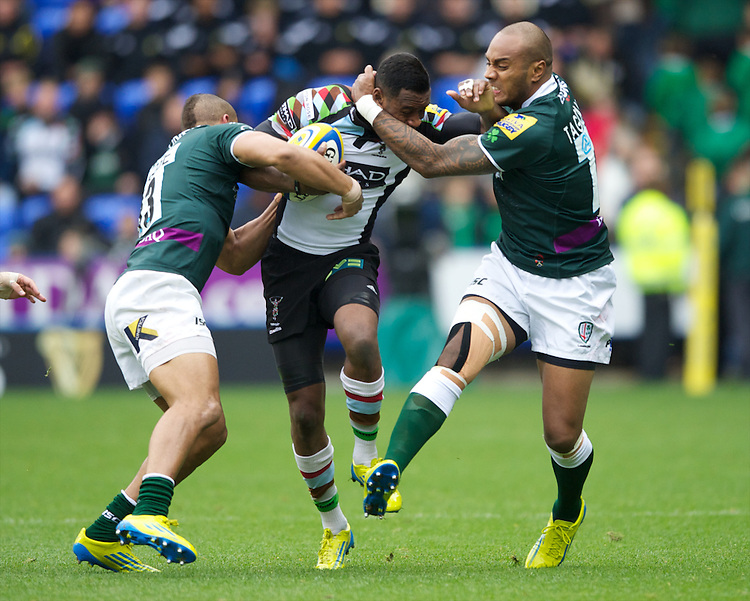 Ugo Monye of Harlequins is tackled by Jonathan Joseph (left) and Sailosi Tagicakibau of London Irish  during the Aviva Premiership match between London Irish and Harlequins at the Madejski Stadium on Sunday 28th October 2012 (Photo by Rob Munro)