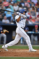 Asheville Tourists right fielder Willie Abreu (6) swings at a pitch during a game against the Charleston RiverDogs at McCormick Field on July 4, 2017 in Asheville, North Carolina. The Tourists defeated the RiverDogs 2-1. (Tony Farlow/Four Seam Images)