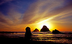 Sunset scene on Oregon Coast south of Manzanita is reached by walking through a tunnel from Oceanside Beach.
