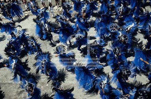 Rio de Janeiro, Brazil. Carnival; Portela samba school; parade; elaborate blue and black feather costumes; stars and moons.