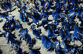 Rio de Janeiro, Brazil. Carnival; Portela samba school; parade; elaborate blue and black feather costumes; stars and moons.
