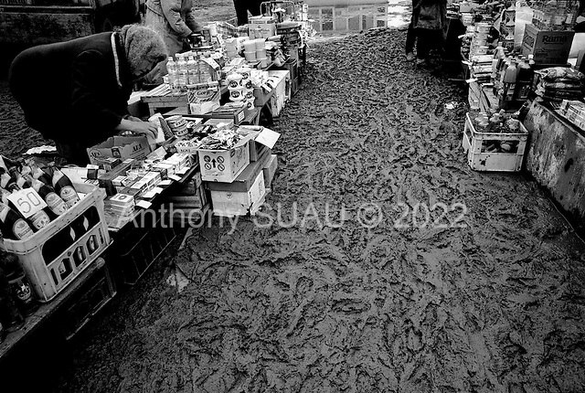 Atyrau, Kazakhstan .1998.A seller in the market with her goods in the oil rich capital of Atyrau. Residents claim that unemployment is at 90% in the region and no one has seen the benefits of the oil they live on. Chevron is heading the consortium in Tengiz, five hours away..