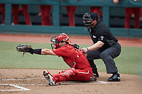 North Carolina State Wolfpack catcher Luca Tresh (24) sets a target as home plate umpire Adam Dowdy looks on during the game against the North Carolina Tar Heels at Boshamer Stadium on March 27, 2021 in Chapel Hill, North Carolina. (Brian Westerholt/Four Seam Images)