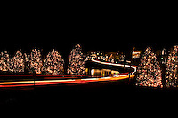 Christmas lights are illuminated as traffic passes through the town of McAdenville, NC. The town of McAdenville has been celebrating Christmas by decorating the homes in town with red, green and white lights and has come to be known as Christmas Town USA.