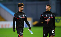 Lincoln City's Jamie Soule, left, with team-mate Ramirez Howarth during the pre-match warm-up<br /> <br /> Photographer Andrew Vaughan/CameraSport<br /> <br /> EFL Trophy Northern Section Group E - Mansfield Town v Lincoln City - Tuesday 6th October 2020 - Field Mill - Mansfield  <br />  <br /> World Copyright © 2020 CameraSport. All rights reserved. 43 Linden Ave. Countesthorpe. Leicester. England. LE8 5PG - Tel: +44 (0) 116 277 4147 - admin@camerasport.com - www.camerasport.com