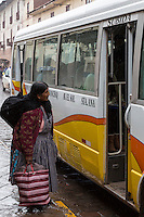 Peru, Cusco.  Old Woman Inquiring about Bus Destination.