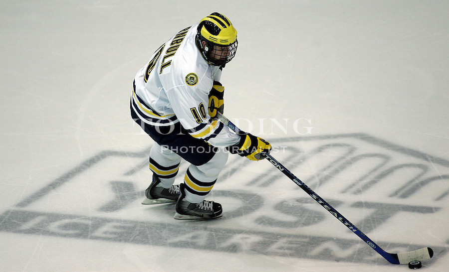 19 October 2006: Michigan forward Travis Turnbull skates with the puck down the rink during Michigan's 6-3 win in their CCHA season opener against Miami (OH) at Yost Ice Arena in Ann Arbor, MI.