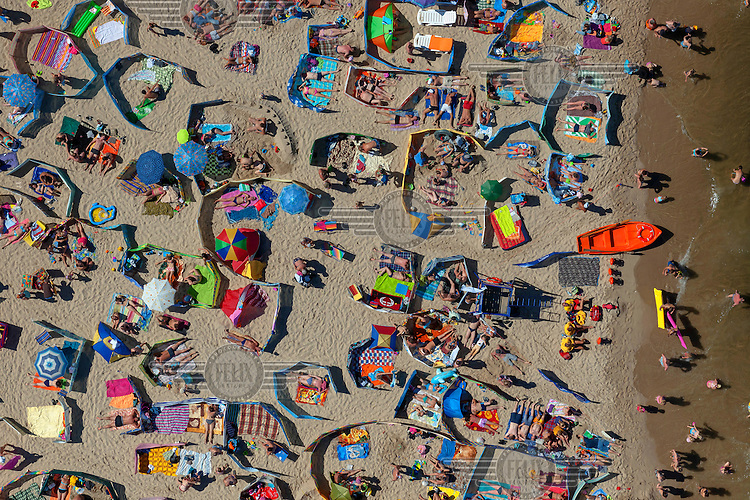Bathers and sunseekers are visible from the air on a beach in Wladyslawowo, small resort town on the Baltic Sea in northern Poland.