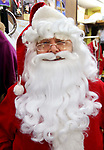 WATERBURY CT. 22 December 2017-122217SV08-Mike Patrick, Republican American, sees what it feels like to transform into Santa at Arabesque on Bank Street in Waterbury Friday. Michael Rinaldi, owner dressed Mike.<br /> Steven Valenti Republican-American