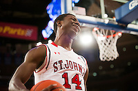 NEW YORK, NY - Sunday December 21, 2015: Kassoum Yakwe (#14) of St. John's shows disappointment after being called for a foul against Seton Hall as the two teams square off in regular season play at Madison Square Garden.