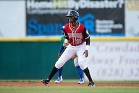 Ti'Quan Forbes (10) of the Hickory Crawdads takes his lead off of second base against the Lexington Legends at L.P. Frans Stadium on April 29, 2016 in Hickory, North Carolina.  The Crawdads defeated the Legends 6-2.  (Brian Westerholt/Four Seam Images)