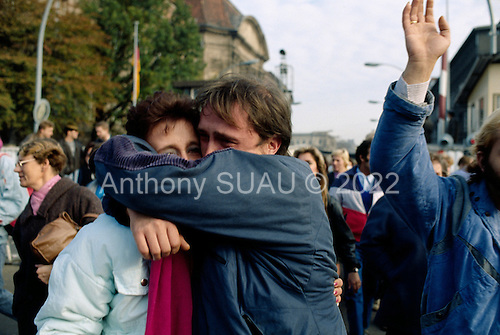 West Berlin, West Germany<br /> November 12, 1989<br /> <br /> An East German man cries as he is reunited with his family. Germans gathered as the wall is dismantled and the East German government lifted travel and emigration restrictions to the West on November 9, 1989.
