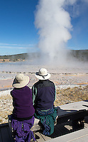 Tourists watch a steam plume at Great Fountain Geyser.
