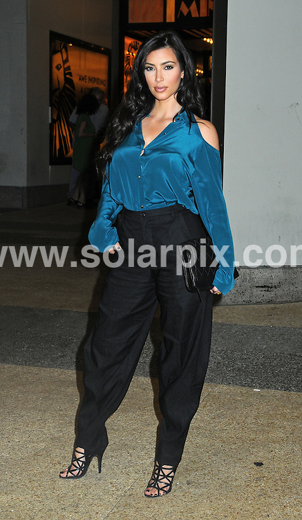 """**ALL ROUND PICTURES FROM SOLARPIX.COM**.**SYNDICATION RIGHTS FOR UK, AUSTRALIA, DENMARK, PORTUGAL, S. AFRICA, SPAIN & DUBAI (U.A.E) ONLY**.Kim Kardashian departs from """"It's On with Alexa Chung Show"""" at the MTV Studios in New York, USA. 29 July 2009..This pic: Kim Kardashian..JOB REF: 9638 PHZ (Mayer)   DATE: 29 July 2009.**MUST CREDIT SOLARPIX.COM OR DOUBLE FEE WILL BE CHARGED**.**MUST NOTIFY SOLARPIX OF ONLINE USAGE**.**CALL US ON: +34 952 811 768 or LOW RATE FROM UK 0844 617 7637**"""