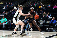 WINSTON-SALEM, NC - FEBRUARY 06: Destinee Walker #24 of the University of Notre Dame drives the baseline during a game between Notre Dame and Wake Forest at Lawrence Joel Veterans Memorial Coliseum on February 06, 2020 in Winston-Salem, North Carolina.