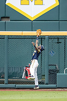 Michigan Wolverines outfielder Christian Bullock (5) makes a leaping catch during Game 6 of the NCAA College World Series against the Florida State Seminoles on June 17, 2019 at TD Ameritrade Park in Omaha, Nebraska. Michigan defeated Florida State 2-0. (Andrew Woolley/Four Seam Images)