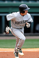 Designated hitter Erik Samples (1) of the USC Upstate Spartans runs out a fly ball in a game against the Furman University Paladins on Tuesday, March 4, 2013, at Fluor Field at the West End in Greenville, South Carolina. Furman won, 13-1. (Tom Priddy/Four Seam Images)